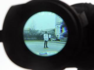 Police officer through a camera viewfinder