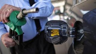 Motorist holding petrol pump