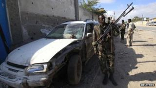 Somali government soldiers patrols the scene of an explosion in capital Mogadishu on 12 September 2012