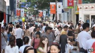 Consumers at a shopping street in Seoul