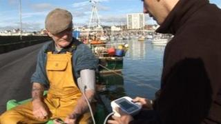 Fisherman getting blood pressure checked
