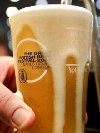 A pint of real ale being poured