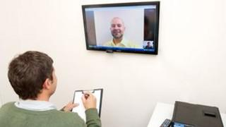 Patient consulting with doctor via webcam