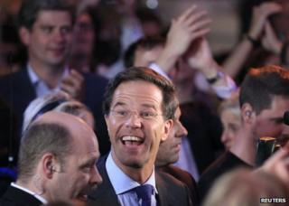 Mark Rutte (centre) celebrates on election night in The Hague, 13 September