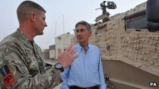 Sergeant Darryl Adams, from 2 Tactical Police Squadron talks to Defence Secretary Philip Hammond