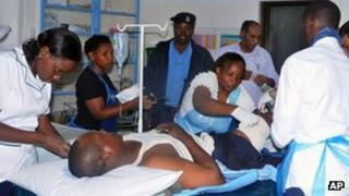 Doctors treat a patient in Mombasa, Kenya on 9 August 2012