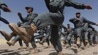 Afghan National Police (ANP) personnel march during a graduation ceremony in Herat