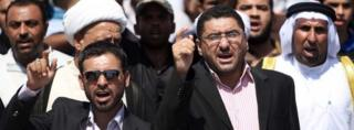 Iraqis chant slogans during a protest in Basra