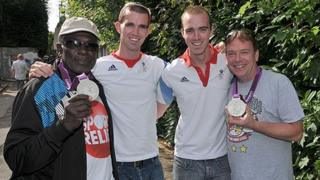 Rudolph Walker (Patrick Trueman) and Adam Woodyat (Ian Beale) try on the Olympic medals.