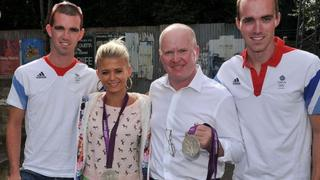 Phil Mitchell and Lola Pearce pose for photos with the brothers.