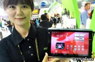 Acer employee shows off tablet