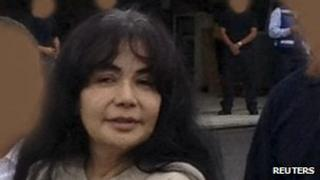 Sandra Avila is escorted to a plane for extradition to the US on 9 August 2012