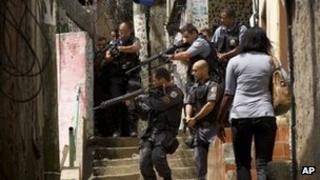Police surround a house in Rocinha