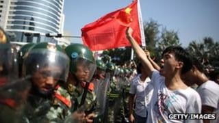 Anti-Japanese protesters confronted by police in Shenzhen, southern China, as they demonstrate over the disputed East China Sea islands, 16 Sept 2012