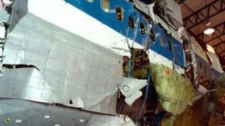 Jumbo jet fuselage showing bomb damage