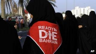 Anti-government protesters take part in a demonstration outside Manama, Bahrain on 14 Sept 2012