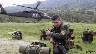 Colombian police land during clashes with Farc rebels