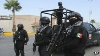 Rapid response Coahuila state police stand at a checkpoint in the city of Piedras Negras, Mexico,