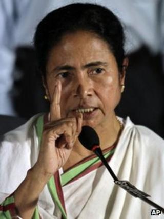 Trinamool Congress party (TMC) leader Mamata Banerjee gestures during a press conference in Kolkata, India, Tuesday, Sept. 18, 2012