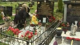 Lorraine Fraser at the grave of Tyrone Clarke