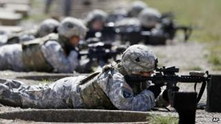 US women soldiers do a rifle trial with new vests on in Fort Campbell, Kentucky 18 September 2012