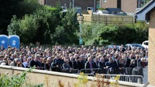 Crowds of mourners outside service