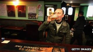 Man drinking in a pub