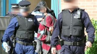 Person being arrested as a part of Operation Hawk