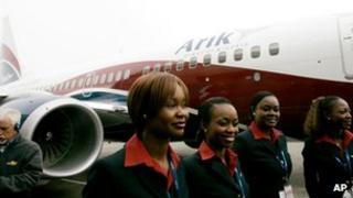 Air stewards stand outside an Arik Air plane in Seattle, US April 2007