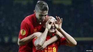 Jonjo Shelvy celebrates one of his two goals