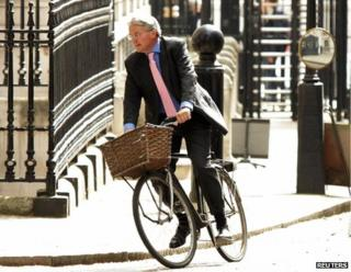 Andrew Mitchell arriving at Downing Street on his bicycle, May 2011
