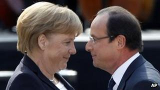 German Chancellor Angela Merkel and French President Francois Hollande in the yard of the castle in Ludwigsburg.