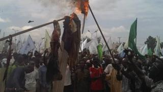 Demonstrators burn flags in Kano