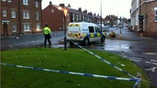 Street cordoned off with police tape