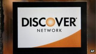 A Discover logo is adhered to a window at the entrance of a shop in Cambridge, Massachusetts 24 September 2012