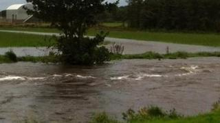 The River Bush has burst its banks in Bushmills