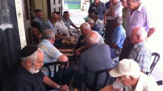 Retired men playing backgammon in Mahane Yehuda market, Jerusalem
