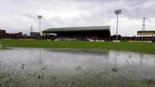 A water-logged pitch at The Oval means Tuesday's County Antrim Shield match between Glentoran and Linfield is off