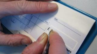 Man writing cheque