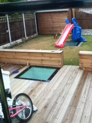 Roof lights in the decking and under the slide betray the presence of the extension