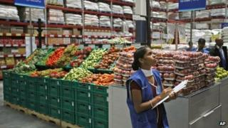 An employee checks the stock inside a newly opened Bharti Wal-Mart store in Hyderabad, India, Wednesday, Sept. 26, 2012