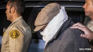 Nakoula Basseley Nakoula leaves his house under police guard