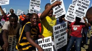 Protesters at the site of the Marikana shooting during the commission visit - Monday 1 October 2012