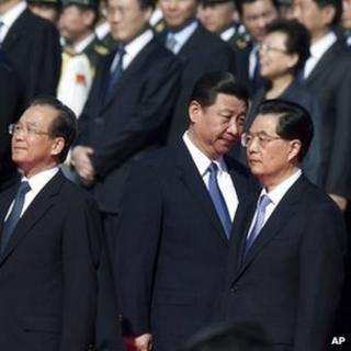 Chinese Vice-President Xi Jinping (centre) walks past President Hu Jintao (right) and Premier Wen Jiabao (left) as he arrives at a ceremony marking National Day at Tiananmen Square in Beijing, 01 Oct 2012