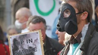 Protestor in gas mask