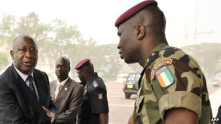 Former President Laurent Gbagbo (L) shaking hands with General Dogbo Ble (R) - file photo