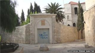 Anti-Christian graffiti sprayed on the door of the Convent of Saint Francis on Mount Zion (2 October 2012)