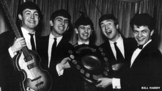 The Beatles with Bill Harry (right)