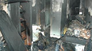 Fire-damaged converted garage in Redbridge