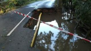 Road damaged by flooding between Linton on Ouse and Newton on Ouse, North Yorkshire